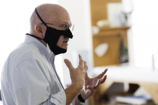 Michael Conley, who is deaf, models a mask that has a transparent panel in San Diego on June 3. Face coverings can make communication harder for people who rely on reading lips, and that has spurred a slew of startups and volunteers to make masks with pl