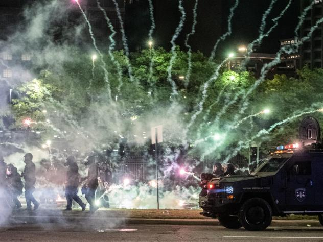 """After covering anti-police brutality protests in May, photojournalists Nicole Hester, Matthew Hatcher and Seth Herald (who took this photo) were shot with rubber pellets by Detroit Police Cpl. Daniel Debono in an """"unprovoked"""" attack, according to prosecu"""
