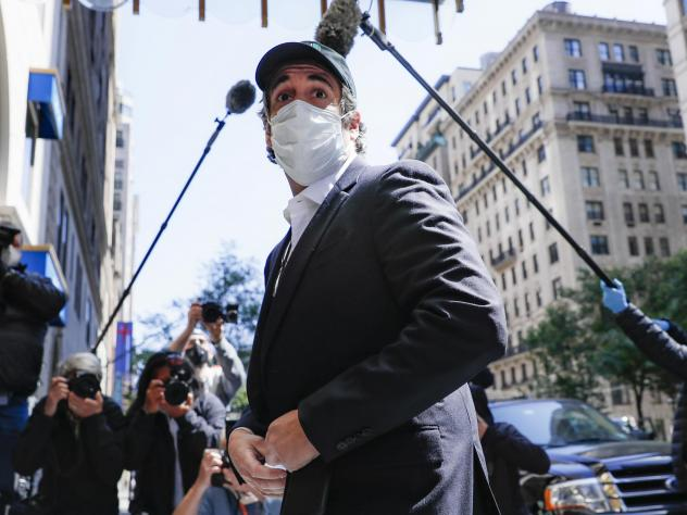 A federal judge found that Michael Cohen's return to prison earlier this month was a violation of his first amendment rights. Cohen, shown here in May, had previously been granted home due to coronavirus concerns.