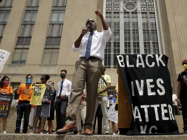 Mayor Quinton Lucas talks to demonstrators during a rally on the steps of City Hall in Kansas City, Mo., on June 5.