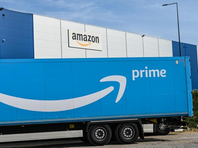 An Amazon delivery truck is parked outside a warehouse in France on April 16. The online retail giant's revenues and profits soared in the second quarter.