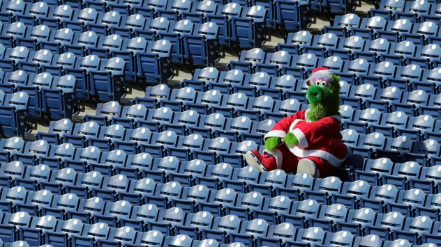 The Phillie Phanatic sits alone in the stands during a game between the Miami Marlins and the Philadelphia Phillies on Saturday. During this series, as many as 19 Marlins players and coaches had already been infected with the coronavirus.