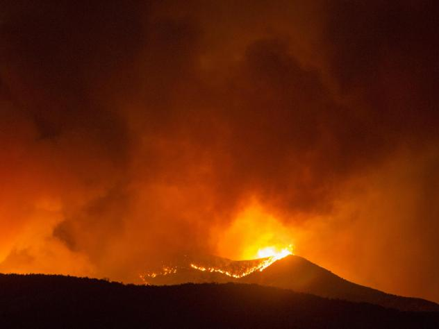 A brush fire burns amid the Apple Fire in Banning, Calif. on Saturday.