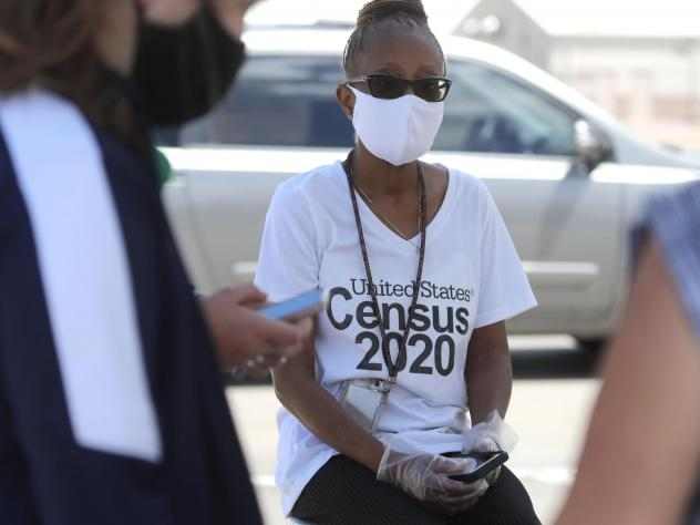 U.S. Census Bureau worker Jennifer Pope wears a face covering at a walk-up counting site in Greenville, Texas, on July 31. The bureau is ending all counting efforts for the 2020 census on Sept. 30, a month shorter than previously announced, the bureau's