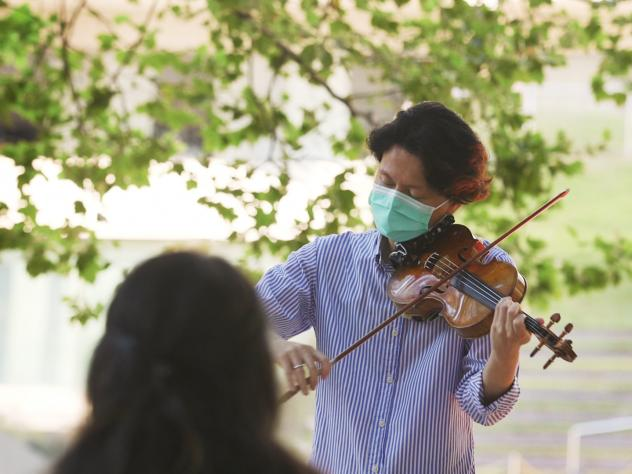 New York Philharmonic first violinist Kuan Cheng Lu, playing for a socially distanced audience of two at Lincoln Center on July 31.