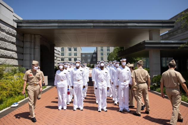 """Plebe Summer Detailers lead a company of incoming freshman students, or """"plebes,"""" at the U.S. Naval Academy in Annapolis, Md."""