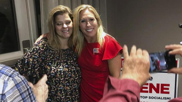 Marjorie Taylor Greene (right) poses with a supporter in Rome, Ga., late Tuesday. Greene, criticized for promoting bigoted videos and supporting the far-right QAnon conspiracy theory, won the GOP nomination for Georgia's 14th Congressional District.