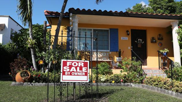 A sale sign is seen in front of a home in Miami. FHA loans are used by many minority, lower-income, and first-time homebuyers because the low down payments make homeownership more affordable. But this demographic is more likely to be hurt financially dur