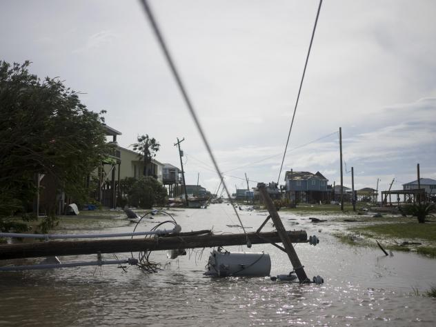 Damaged homes sit among floodwaters after Hurricane Laura passed through the area Thursday in Holly Beach, La.