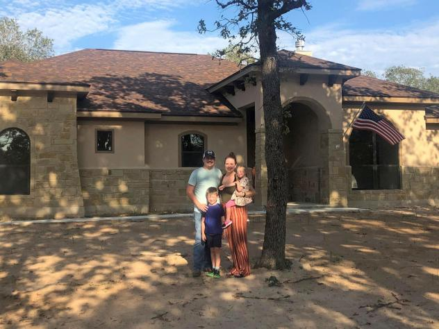 Caroline Wells and her family at their new home outside San Antonio. The builders just finished it so the yard has yet to be planted, but the couple is looking forward to letting the kids run out their energy with a lot more outdoor space than they had a