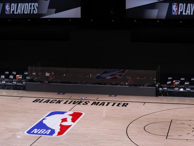 An empty court and bench are shown with no signage following the scheduled start time of Wednesday's NBA playoff series. NBA players made their strongest statement yet against racial injustice Wednesday when the Milwaukee Bucks didn't take the floor for