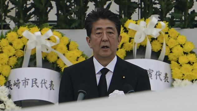 Japanese Prime Minister Shinzo Abe speaking during a ceremony to mark the 75th anniversary of the U.S. atomic attack at the Hiroshima Peace Memorial Park on August 6. Abe announced his resignation Thursday.