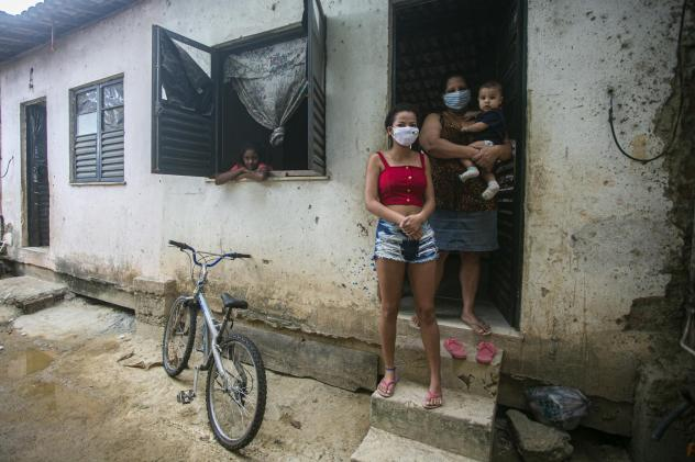 Flaviane da Conceição, 40, a self-employed house cleaner, poses for a photo at her home in the Cidade de Deus favela on July 29 in Rio de Janeiro, Brazil. A single mother of three, she applied for government emergency aid at the beginning of the corona