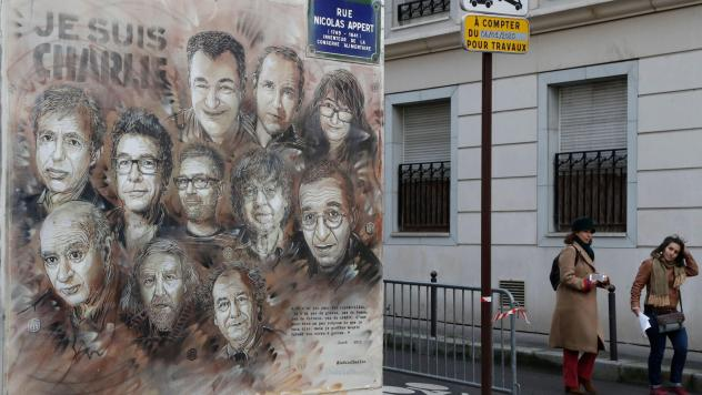 """The work of French street artist Christian Guemy aka """"C215"""" depicting members of satirical magazine <em>Charlie Hebdo</em> is painted on a facade near the magazine's offices at Rue Nicolas Appert in Paris, to commemorate the fifth anniversary of the atta"""