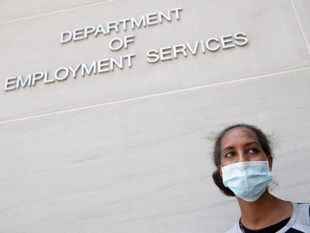 Diana Yitbarek seeks information about her unemployment claim in Washington, D.C., in July. Applications for jobless benefits nationwide have been dropping but remain very high by historical standards.