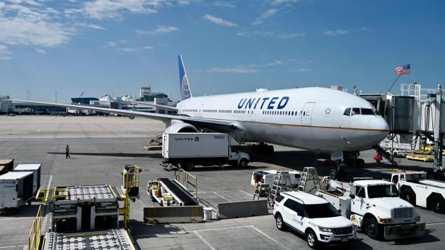 A United Airlines plane sits at the gate at Denver International Airport on July 30. The airline industry has been hit hard by the coronavirus pandemic.