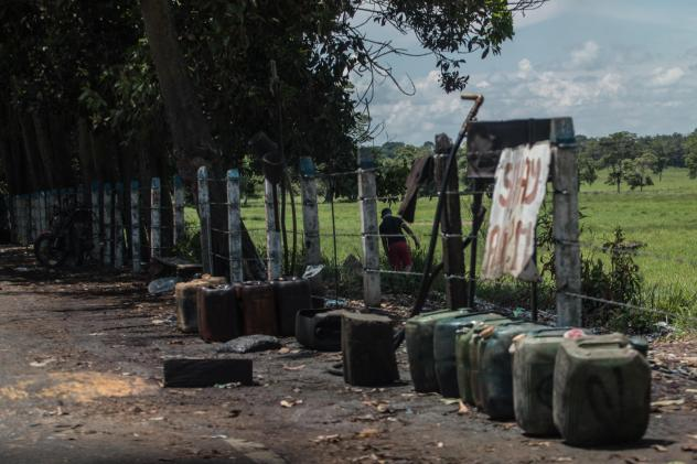 Contraband fuel sits on the side of a road in Puerto Santander, Colombia, on May 31, 2019. The Venezuelan government's lack of cash to import gasoline combined with U.S. sanctions targeting the oil sector have led to chronic fuel shortages in Venezuela.