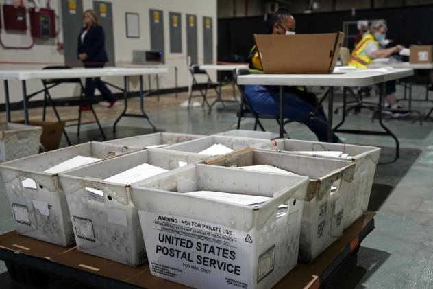 Workers prepare absentee ballots for mailing Thursday at the Wake County Board of Elections in Raleigh. Other states will soon follow North Carolina in sending out ballots as the general election voting season gets underway.