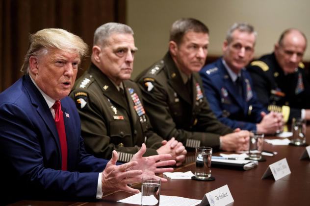 Army Gen. Mark Milley (second from left), chairman of the Joint Chiefs of Staff, and others listen as President Trump speaks during a meeting with senior military leaders in October.