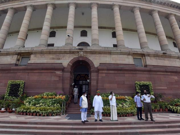 Politicians gathered at India's Parliament House ahead of the first session in six months, on Sept. 13 in New Delhi. Lawmakers were required to get tested for the coronavirus within 72 hours before entering parliament.