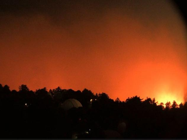 A view facing east from the Mount Wilson Observatory near Los Angeles shows the nearby flames of the Bobcat Fire early Wednesday.