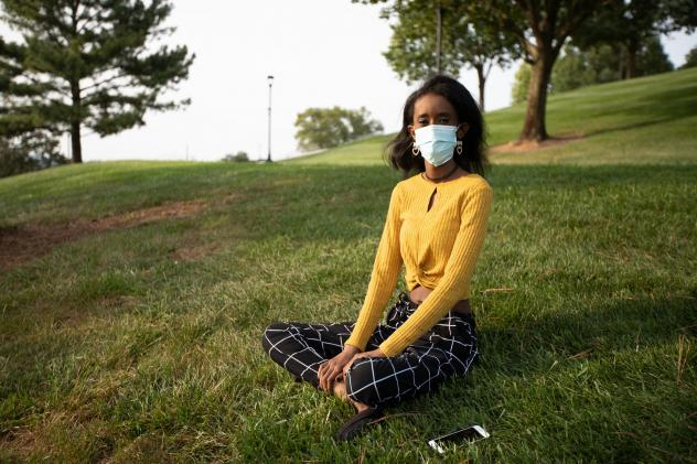 Huda Mohamed, a student at James Madison University in Harrisonburg, Va., has an immunodeficiency. She decided to take extra precautions by using Virginia's COVIDWISE app, which alerts users who may have been exposed to the coronavirus. Such apps are onl