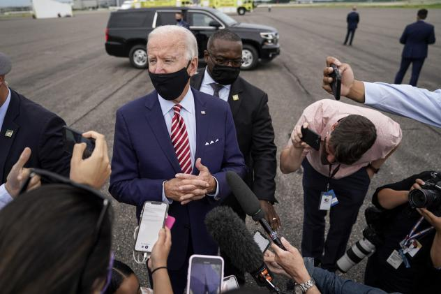 Democratic presidential nominee Joe Biden speaks to reporters before boarding his plane in Florida on Tuesday. Biden leads by 9 points against President Trump, who continues to face an uphill reelection battle.