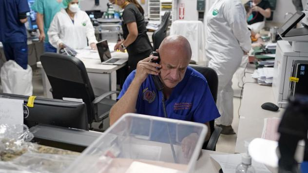 """Dr. Joseph Varon notifies the family of a patient who died inside the coronavirus unit at Houston's United Memorial Medical Center on July 6. Varon tells NPR he's """"living on adrenaline."""""""