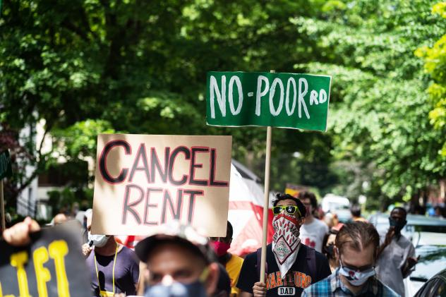 Demonstrators march in Chicago's Old Town neighborhood in June to demand a lifting of the Illinois rent control ban and a cancellation of rent and mortgage payments. The pandemic's financial pressures are causing many Americans to struggle with rent paym