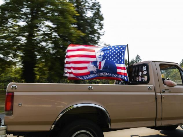 """Vehicles make their way along Interstate 205 South during the """"Oregon for Trump 2020 Labor Day Cruise Rally"""" earlier this month at Clackamas Community College in Oregon City."""