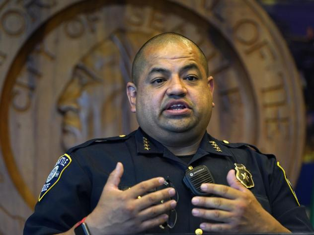 Interim Seattle Police Chief Adrian Diaz addresses a news conference about changes being made at the department, earlier this month. The SPD announced Thursday that an officer seen on video rolling his bicycle over a downed protester was suspended pendin
