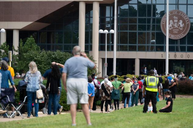 Voters wait in line to cast their ballot at an early voting location in Fairfax, Va., on Sept. 18. Growing tensions in the country have some election officials worried about potential violence at polling places.