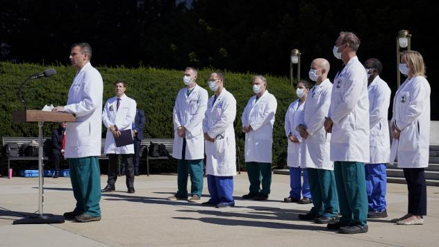 Dr. Sean Dooley briefs reporters at Walter Reed National Military Medical Center in Bethesda, Md. on Saturday. Trump was admitted to the hospital after contracting the coronavirus.