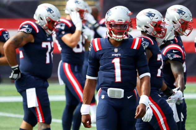 Cam Newton of the New England Patriots looks on before a game against the Las Vegas Raiders at Gillette Stadium last Sunday. A game between the Patriots and Kansas City Chiefs was postponed after players from both teams tested positive for the coronaviru