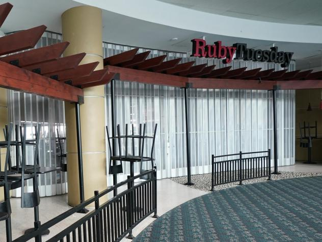 Chairs are stacked outside a closed Ruby Tuesday restaurant at Orlando Intercontinental Airport on May 24, 2020.