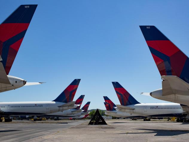 Dozens of Delta jets have been parked on the tarmac of the Birmingham-Shuttlesworth International Airport since last spring. The airline reported $5.4 billion in third quarter losses on Tuesday.