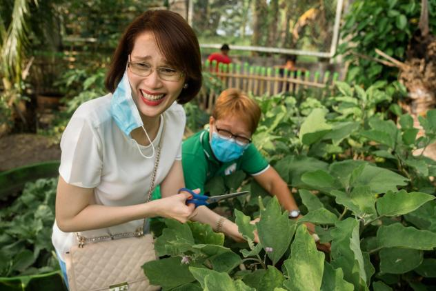 """Geraldine Roman, the first openly transgender person to be elected to the Philippine Congress, visits a vegetable garden in Bataan. She leads a program called Oh My Gulay — <em>gulay</em> is Tagalog for """"vegetables."""" It encourages people to grow veg"""