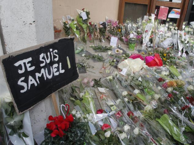 Authorities in France say they've detained nine people in connection with the decapitation of a history teacher in a Paris suburb on Friday. The teacher had shown caricatures of the Prophet Muhammad to his class, authorities said.