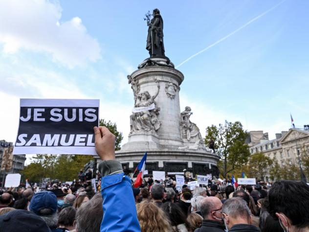 "Demonstrators like the one shown here carried ""I am Samuel"" signs as they gathered on Place de la République in Paris on Sunday to pay tribute to slain history teacher Samuel Paty. Similar gatherings took place in several other cities as France reels fr"