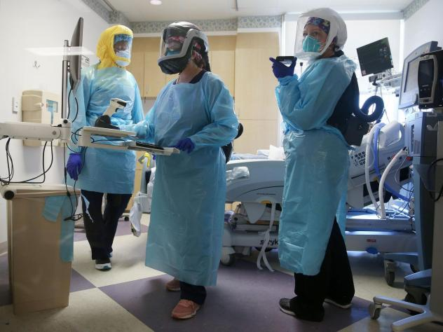 COVID-19 mortality rates are going down, according to studies of two large hospital systems, partly thanks to improvements in treatment. Here, clinicians care for a patient in July at an El Centro, Calif., hospital.