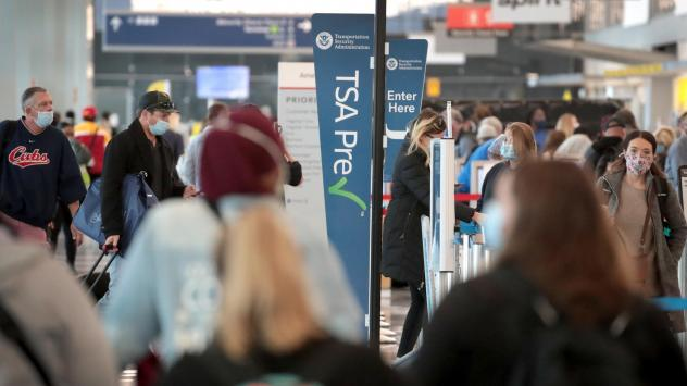 Passengers enter a checkpoint at O'Hare International Airport on Monday. The TSA reports it screened over 1 million passengers on Sunday, the highest number since the coronavirus crisis began.