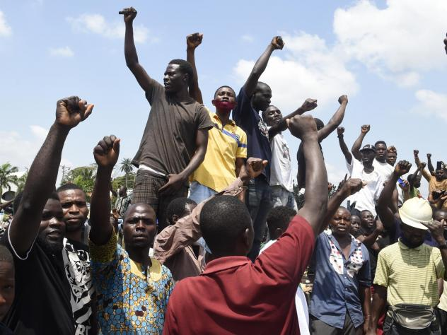 Protesters chant and sing solidarity songs as they barricade barricade the Lagos-Ibadan expressway on Wednesday to protest against police brutality and the killing of protesters by the military, at Magboro, Ogun State, Nigeria.