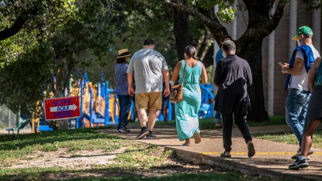 Voters approach a polling location in Austin, Texas, on Oct. 13 — the first day of voting in the state. Nearly 10 million ballots have already been cast in Texas — more than 2016's total votes in the state.