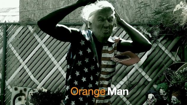 "A screenshot from Sunny War's video for ""Orange Man."""