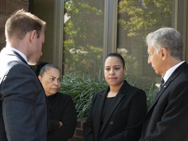 Rulennis Munoz (center right) outside Lancaster Courthouse Oct. 14, after learning that the police officer who fatally shot her brother had been cleared of criminal wrongdoing by the Lancaster County District Attorney. Her mother, Miguelina Peña, and he