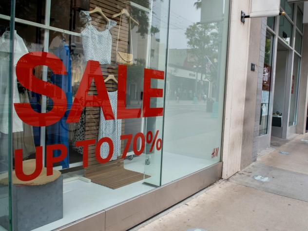 A store advertises discounts in Santa Monica, Calif., on July 28 amid the coronavirus pandemic. Economic growth data on Thursday are expected to show a record-setting figure for the third quarter, but that covers the more worrisome picture underneath the