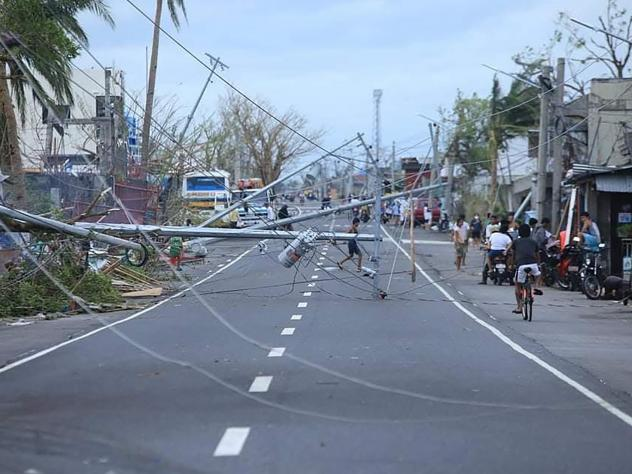 Typhoon Goni downed electric posts in Tabaco, Albay province, in addition to causing deadly flooding and storm surge when it struck the Philippines on Sunday.