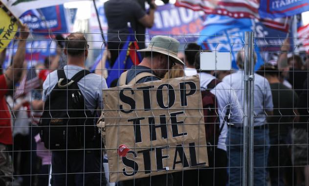 """Supporters of President Trump demonstrate at a """"Stop the Steal"""" rally in front of the Maricopa County Elections Department office in Phoenix on Saturday. Domestic terrorism analysts warn that a prolonged fight and Trump's statements about the vote only f"""