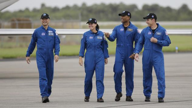 From left, astronaut Soichi Noguchi of Japan and NASA astronauts Shannon Walker, Victor Glover and Michael Hopkins walk after arriving at Kennedy Space Center in Cape Canaveral, Fla. The four astronauts will fly on the SpaceX Crew-1 mission to the Intern
