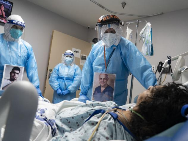 Medical staff members check on a patient at the COVID-19 ICU in United Memorial Medical Center in Houston, Texas. Cases and hospitalizations rose dramatically in the U.S. this week.